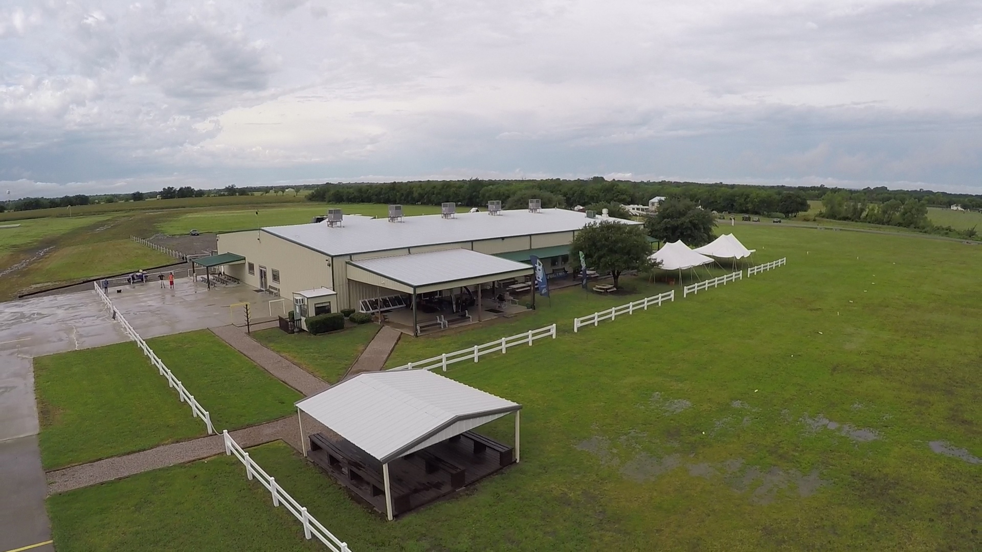 Our main facility includes a large building for classrooms, packing, deli, and covered loading areas for skydivers waiting to board the planes.