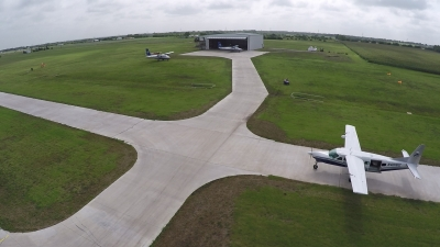 Aircraft at the maintenance hangar and approaching the main loading area.