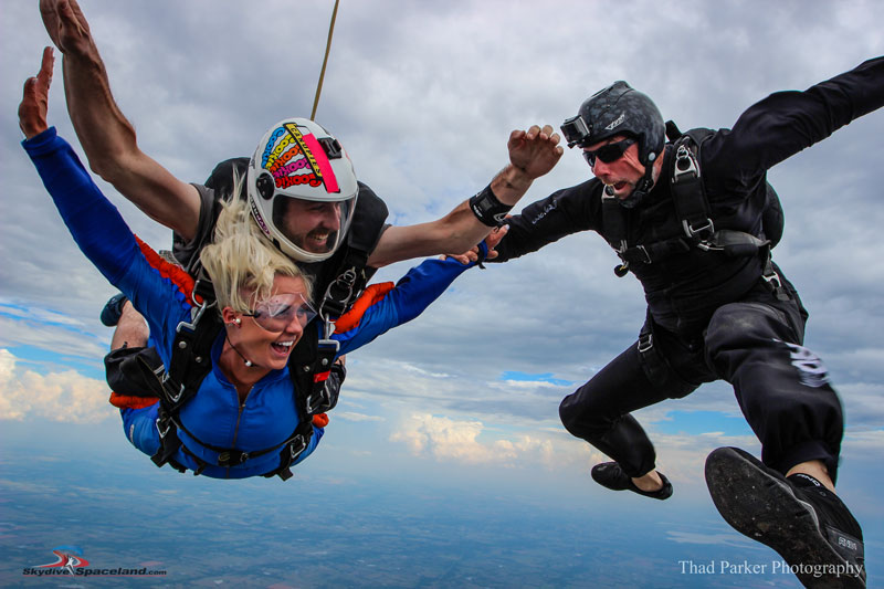 Tandem skydiving videographer tricks